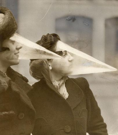 Two women modelling snowstorm masks in the 1920s, an unusual invention