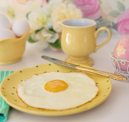 A fried egg around other Easter decorations