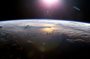 Our planet (Earth, I seem to recall) viewed from space, with Mr. Sun up ahead. Hurray for Space!