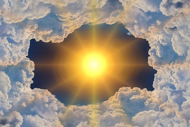 A very bright Sun parting clouds, suggesting a heatwave