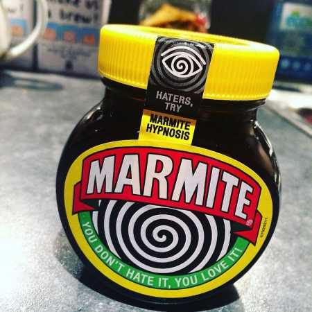 A jar of Marmite with its hynopnotising label
