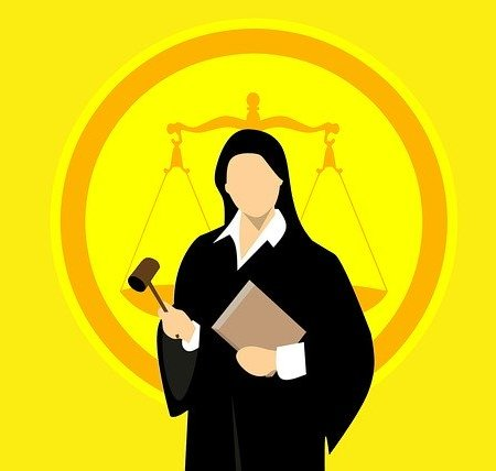 A judge in a court of law holding a gavel