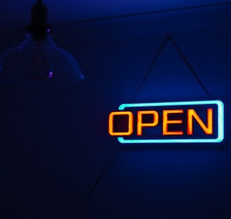 A sign that says open.
