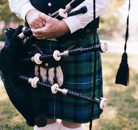 A man wearing a kilt male skirt