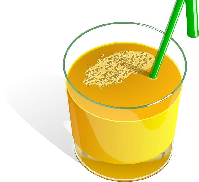 Orange juice without bits, and a straw in the juice