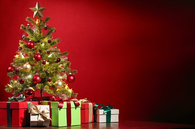 A Christmas tree surrounded by presents