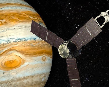 Jupiter with a human spacecraft flying by it