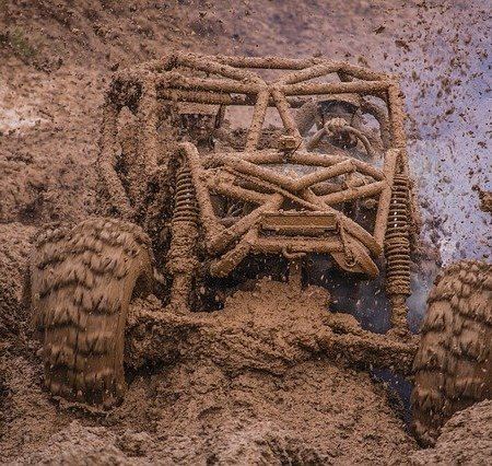 A 4x4 blasting through a lot of mud
