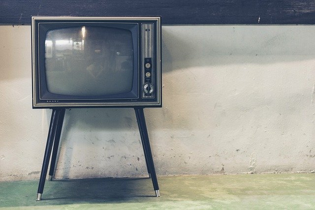An old TV standing against a wall