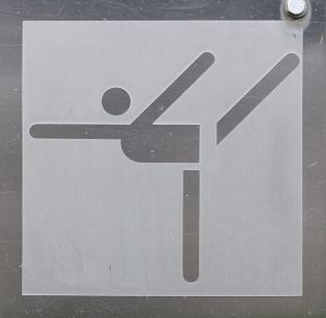 The 1972 Olympic sign for Gymnastics. Either that or it's someone fslipping and falling over.