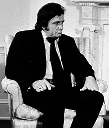 "Johnny Cash. ""Cash"" suggests ""money"" so here's the link."