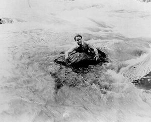 Harry Houdini in the Niagra Falls.