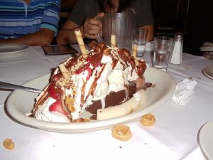 One very massive banana split = one very happy baboon.