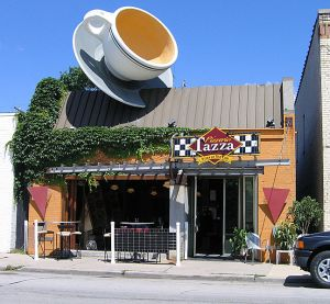 """Although it's now a Pizzeria, this Milwaukee, Wisconsin shop decided against removing the massive cup off its roof. Why? """"G-g-g-g-g--ghooosts!"""" breathed the owner."""