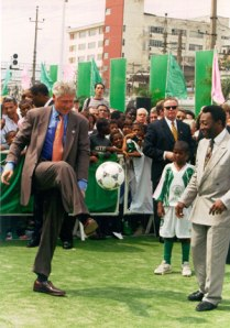 "Pelé and Bill Clinton kick a ""soccer"" ball. This isn't at all surreal."