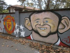 Wayne Rooney on a wall.