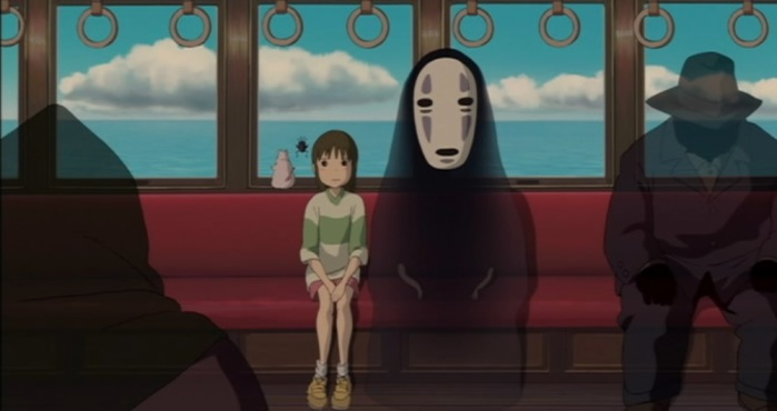 Sen and No Face sitting on a train in Spirited Away