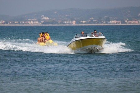 Speed boat and a banana boat on the ocean