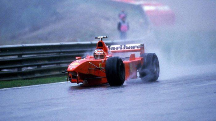 Michael Schumacher driving a broken Ferrari at Spa in 1998
