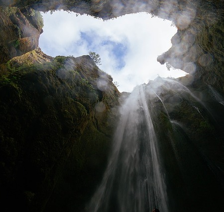 An extravagant crevice with a waterfall