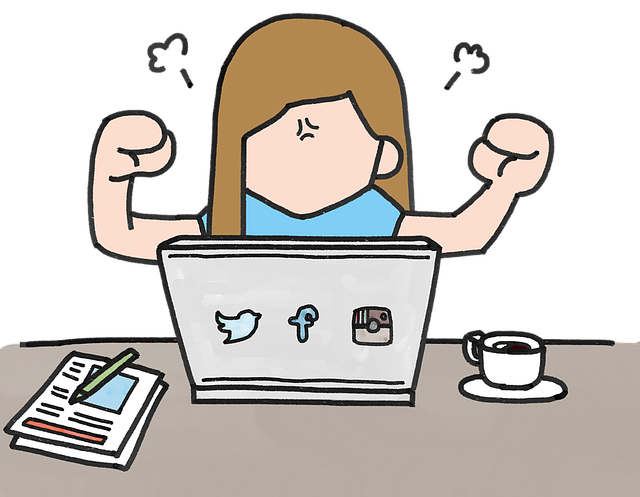A cartoon lady getting angry next to her laptop