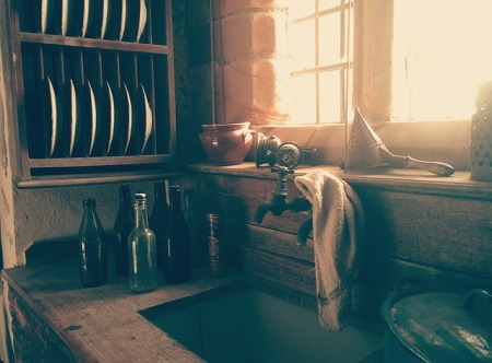 Kitchen and a sink with bottles