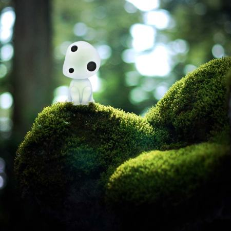 Kodama tree spirit on a mossy log