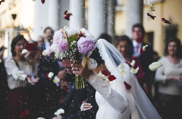 A woman getting married with a bunch of flowers