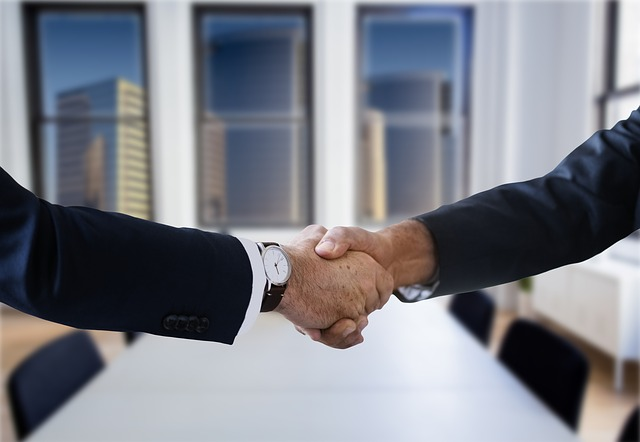Shaking hands in an office