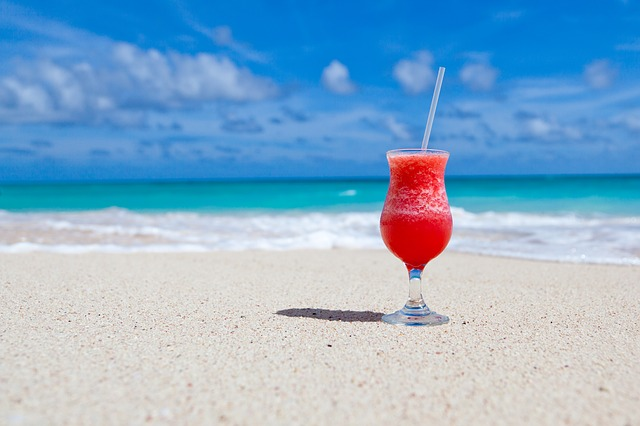 A cocktail on a beach during summer