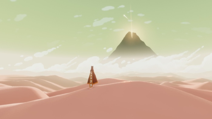 Journey game- robed figure in the desert with a mountain ahead