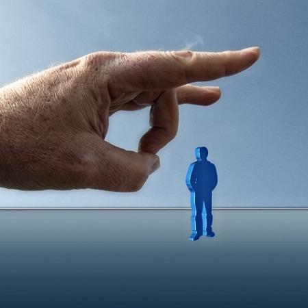 A giant hand flicking a man figure, firing the employee immediately