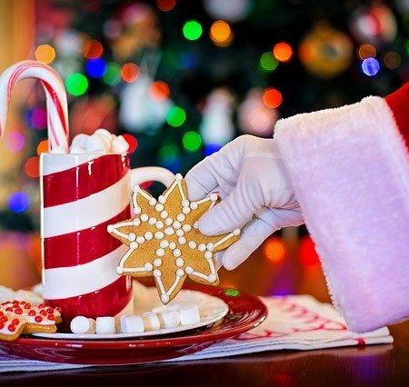 Santa Claus picking up a Christmas item