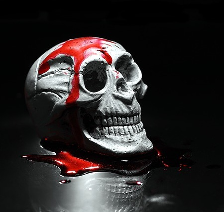 A human skull covered in horrifying blood