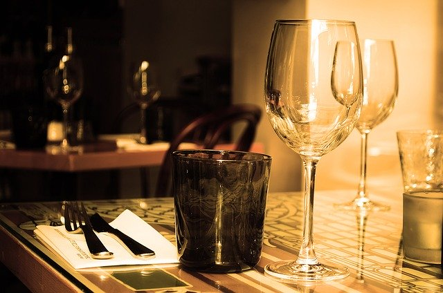 Romantic dinner setting with wine glasses and candles