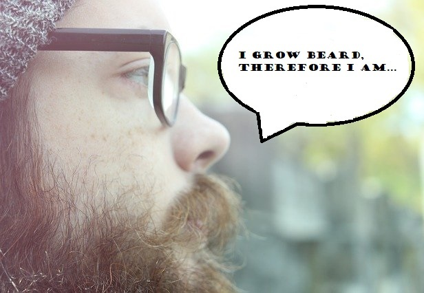 A hipster in glasses and a beard