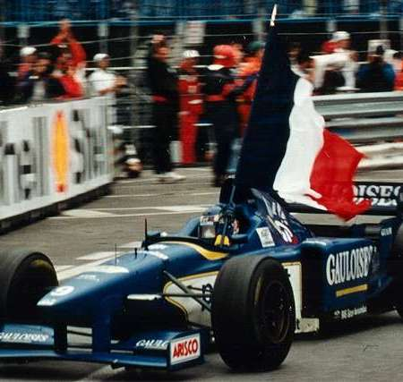 Olivier Panis waving the French flag at the Monaco GP 1996