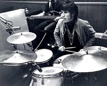 Drummer John Densmore sitting behind his kit