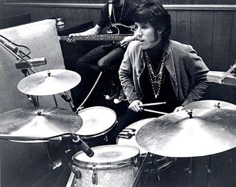 Drummer John Densmore sitting behind his kit