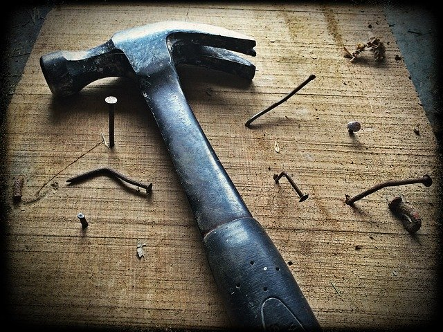 A hammer with bent nails following some DIY