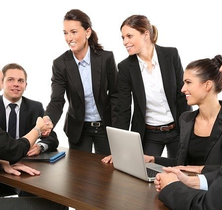 Business people having a meeting with two shaking hands