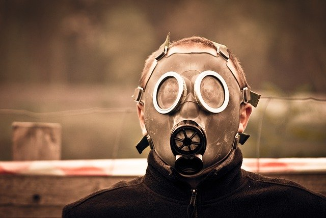 A man standing in a gas mask