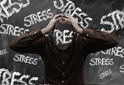 A man holding his head in stress