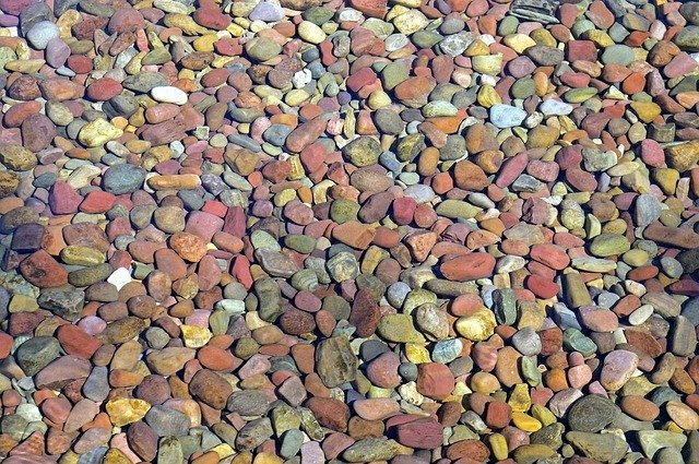 Some skimming stone pebbles under water