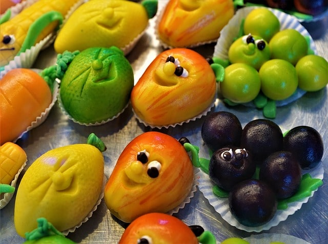 An assortment of fun marzipan shapes for a dessert.