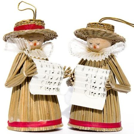 Toy figurines singing Christmas carols