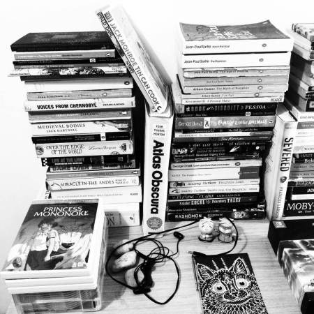 A book collection in black and white, with a DVD of Princess Mononoke
