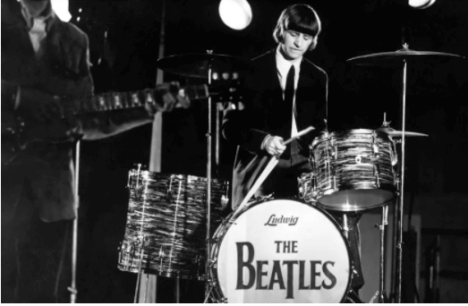 Ringo Starr playing the drums with The Beatles
