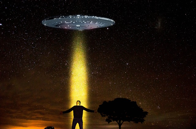 An alien spaceship abduction of a man at night