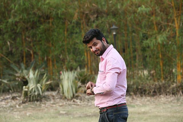 A man wearing a pink shirt
